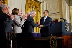 President Barack Obama shakes hands with Reid after signing the Omnibus Public Lands Management Act of 2009 on March 30, 2009.