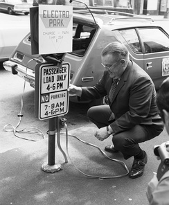 This 1973 photo of a charging station in Seattle shows an AMC Gremlin modified to take electric power; it had a range of about 50 miles on one charge.