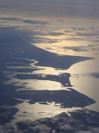 A high aerial view of Portsea Island (the island which Portsmouth is situated on), and neighbouring Hayling Island