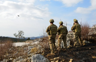 U.S. Army paratroopers assigned to the Company B, 2nd Battalion, 503rd Infantry Regiment, 173rd Airborne Brigade, observe a U.S. Air Force F-16 Falcon during close air support training at Pocek Range in Postojna, Slovenia, March 12, 2015.