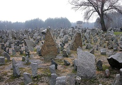 Memorial at Treblinka II, with 17,000 quarry stones symbolising gravestones.[24] Inscriptions indicate places of Holocaust train departures, which carried at least 5,000 victims each, and selected ghettos from across Poland.