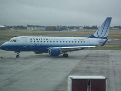 United Express Embraer 170 begins taxiing for departure.