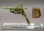 A Chinese crossbow mechanism with a buttplate from either the late Warring States Period or the early Han dynasty; made of bronze and inlaid with silver