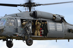 Pararescuemen prepare to rappel from a 57th Rescue Squadron HH-60G Pave Hawk during exercise Joint Warrior 15-1