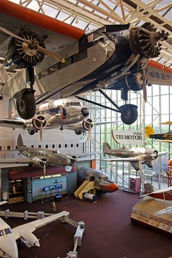 Aircraft on display at the National Air and Space Museum, including a Ford Trimotor and Douglas DC-3 (top and second from top)