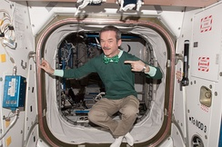 Astronaut Chris Hadfield wearing green in the International Space Station on St Patrick's Day, 2013