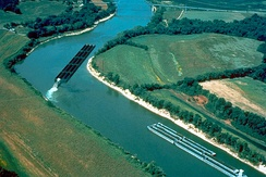 Multiple barges pushed around a tight bend on the Cumberland River
