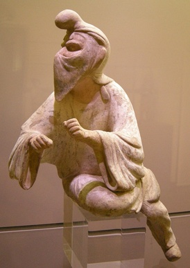 An 8th century Tang dynasty Chinese clay figurine of a Sogdian man wearing a distinctive cap and face veil, possibly a camel rider or even a Zoroastrian priest engaging in a ritual at a fire temple, since face veils were used to avoid contaminating the holy fire with breath or saliva; Museum of Oriental Art (Turin), Italy.[43]