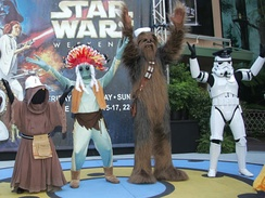 "Star Wars characters, a Jawa, Greedo, Chewbacca and an Imperial Stormtrooper, assume the roles of the Village People for the ""Y.M.C.A."" dance at a Disney ""Star Wars Weekends"" event in 2007."