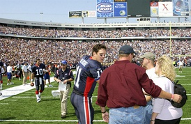 Bledsoe greeting family members of fallen Iraq War personnel before a game with the Bills in 2003