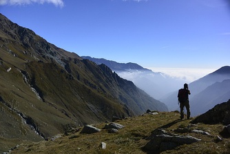 A hiker enjoying the view of the Alps