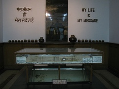 An exhibit showing blood-soaked loin cloth and shawl of Mahatma Gandhi, and the bullet that took his life.