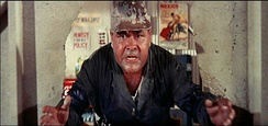 Jonathan Winters crashes through a wall. It's a Mad, Mad, Mad, Mad World (1963)