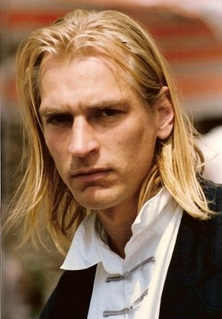 Julian Sands at the 1990 Cannes Film Festival. He had grown his hair long for the character of Franz Liszt in Impromptu.