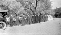 Line of young people at a commencement ceremony. USA, early-20th century.