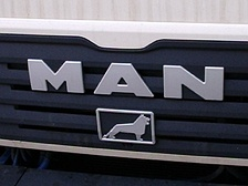 This logo is on the front of all MAN trucks and buses. The lion comes from Büssing AG, a company that MAN acquired in 1971.  It resembles the coat of arms of the city of Brunswick.
