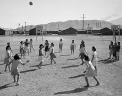 Japanese American women playing volleyball, Manzanar internment camp, California, ca. 1943