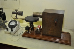 Bose's 60 GHz microwave apparatus at the Bose Institute, Kolkata, India. His receiver (left) used a galena crystal detector inside a horn antenna and galvanometer to detect microwaves. Bose invented the crystal radio detector, waveguide, horn antenna, and other apparatus used at microwave frequencies.
