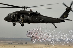 Soldiers from the U.S. Army's 350th Tactical Psychological Operations, 10th Mountain Division, drop leaflets over a village near Hawijah in Kirkuk province, Iraq, on March 6, 2008.