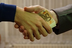 Giving money to influence a person's behavior is a form of bribery.