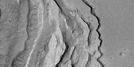 Tilted layers formed when ground collapsed, as seen by HiRISE, under HiWish program.