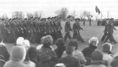 Mobilized 434th Troop Carrier Wing passes in review prior to being mustered from active service at Bakalar AFB, Indiana, on 27 November 1962, following the Cuban missile crisis.