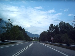 The A8 Autostrasse in Switzerland. Notice the speed limit, which is repetitively indicated, and the lack of a central physical barrier