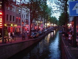 The red-light district in Amsterdam (2003). Red is the sex industry's preferred color in many cultures, due to being strongly associated with passion, love and sexuality.[4]:39–63