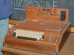 Apple's first product, the Apple I, invented by Apple co-founder Steve Wozniak, was sold as an assembled circuit board and lacked basic features such as a keyboard, monitor, and case. The owner of this unit added a keyboard and wooden case.