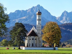 A Catholic church near Füssen with the Alps in the background