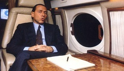 Berlusconi in his private jet, in the 1980s