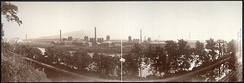 The Blast furnaces of Bethlehem Steel seen in a panoramic view from the north bank of the Lehigh River. South Mountain is in the distance. (c. 1896).