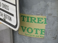 "Remnant of Whittaker's campaign bumper sticker, photographed on a light pole on South Cushman Street in Fairbanks in 2014.  The bumper sticker read ""Tired of Ted?  Vote for Jed!""."