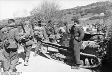 Albanian and German soldiers next to an Italian tank