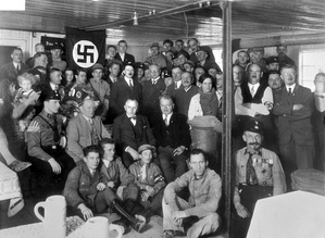 Hitler with Nazi Party members in December, 1930
