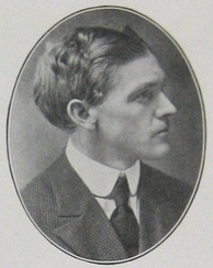 Head and shoulders of a man of about 35 in profile in an oval frame. He is wearing a dark suit and tie and a white collar. His hair is dark, full, and wavy.