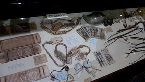 Display on divination, featuring a cross-cultural range of items, in the Pitt Rivers Museum in Oxford, England.