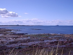 View towards Belhaven Bay (John Muir Country Park) with North Berwick Law and Bass Rock in the distance.