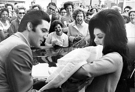 Elvis and Priscilla with Lisa Marie in February 1968