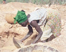 Woman panning for gold in Guinea