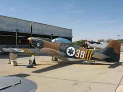 P-51D at the Israeli Air Force Museum; the marking beneath the cockpit notes its participation in the wire-cutting operation at the onset of the Suez Crisis.