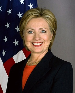 Hillary Clinton dressed in a black suit seen in her official secretary of state portrait in 2009