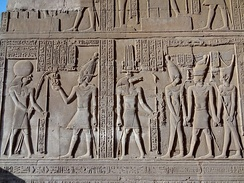 Relief from the temple of Kom Ombo depicting Ptolemy VIII receiving the sed symbol from Horus.[37]