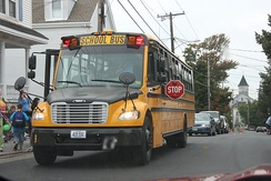 School bus with red warning lights and deployed stop arm