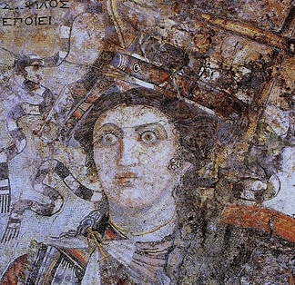 A mosaic from Thmuis (Mendes), Egypt, created by the Hellenistic artist Sophilos (signature) in about 200 BC, now in the Greco-Roman Museum in Alexandria, Egypt; the woman depicted is Queen Berenice II (who ruled jointly with her husband Ptolemy III Euergetes) as the personification of Alexandria, with her crown showing a ship's prow, while she sports an anchor-shaped brooch for her robes, symbols of the Ptolemaic Kingdom's naval prowess and successes in the Mediterranean Sea.[20]