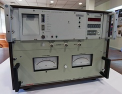 A caesium atomic clock from 1975 (upper unit) and battery backup (lower unit).[33]