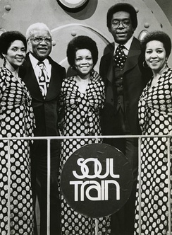 Soul Train host Don Cornelius (second from right) with The Staple Singers in 1974.