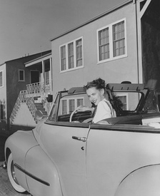 Peters driving in October 1947; her vehicle was refitted with a hand-accelerator and brakes to allow her to drive after her paralysis