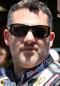 Image of man in his forties, wearing sunglasses and with a shaved beard.