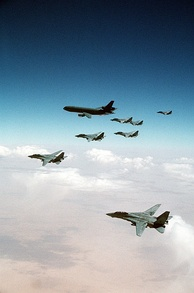 F-14 Tomcats from the Red Sea and Persian Gulf await their turn refueling from a KC-10A over Iraq during the Gulf War.